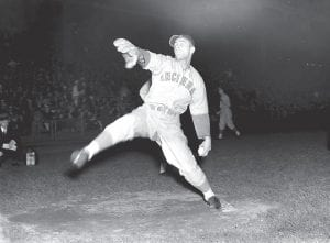 Cincinnati Reds' lefty Johnny Vander Meer warmed up before a game against the Brooklyn Dodgers which marked the first night game at Ebbets Field, June 15, 1938. Vander Meer added to the historical significance of the game by pitching his second consecutive no-hitter, a Major League baseball record that still stands. (AP Photo)