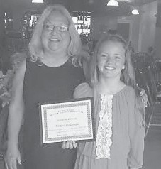 "The Letcher County Retired Teachers Association recently honored Abigail McDougal as the winner of Letcher County's ""Why My Grandparent Should Be Grandparent of the Year"" essay contest. The contest is sponsored by AARP and the Kentucky Retired Teachers Association. Pictured with Abigail is her grandmother, Charlett McDougal."