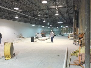 EXPANSION UNDERWAY — Food City grocery in Whitesburg will be significantly larger when this addition to the store opens in early fall. The space shown in this photo formerly housed East Kentucky Physical Therapy, which has moved into a new building erected nearby. The new construction will allow Food City to expand many of its offerings and will feature a section dedicated to fresh seafood. Superior Pharmacy will move its operation to a space in the front of the store.