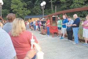 SHOWING THEY CARE — Several citizens gathered at the James Bates Bridge in downtown Whitesburg on June 19 to express their sympathy for the victims of the recent mass shooting at an Orlando, Florida nightclub that left 49 innocent persons dead and 53 wounded. (Photo by Tanya Bernice Turner)