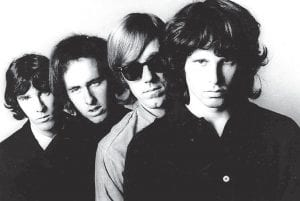 """The Doors fire up radio in 1967 On July 7, 1967, a now-classic song by The Doors, """"Light My Fire,"""" hit Number One on the Billboard Top 40 charts. The song appears on the band's 1967 debut album, The Doors. Members of the band are, from left, John Densmore, Robbie Krieger, Ray Manzarek and Jim Morrison. (AP Photo)"""