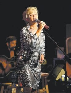 More than 3,500 people braved stormy weather Monday night to see a free Fourth of July concert by country music star Lorrie Morgan at River Park in Whitesburg. The concert and a 45-minute fireworks show were sponsored by the City of Whitesburg. (Photo by Thomas Biggs)