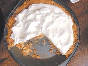 The beauty of this Atlantic Beach Pie lies in the play between the salty, dense crust made from soda crackers and the creamy sweet-and-tart filling featuring citrus juice. (Katie Workman via AP)