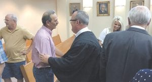 "New Letcher Circuit Judge James W. ""Jimmy"" Craft speaks with Kingscreek resident Wesley Hogg Monday morning after Craft was sworn into office by Kentucky Supreme Court Justice Sam Wright, whose unexpired term Craft was appointed to fill. A formal ceremony will be held later this month."