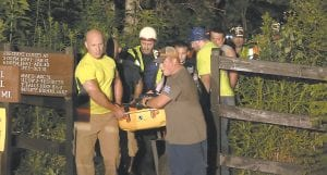 Volunteers and first responders carried 22-year-old Kara Kennedy of Wise, Va., off the trailhead at Bad Branch Falls Nature Preserve in Eolia. Kennedy fell from near the top of Bad Branch Falls on July 13 while hiking with her boyfriend. Kennedy was critically injured and has been treated at Pikeville Medical Center since her fall. The accident resulted in her losing the lower part of her right leg. (Screen shot courtesy EKB)