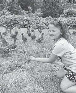 — Lauren Allison Hicks, 8, fed the ducks in the Dairy Queen parking lot in Whitesburg recently. She is the granddaughter of Cathy and Charles Ronald Hicks of Bottom Fork, and has been visiting them for the past two weeks.
