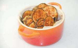 This photo shows baked BBQ zucchini chips in Coronado, Calif. This dish is from a recipe by Melissa d'Arabian. (Melissa d'Arabian via AP)