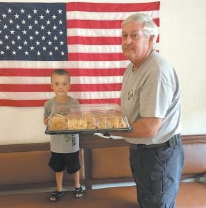 Five-year-old Drake Wright presented cookies to Whitesburg Fire Chief Gary Mullins in appreciation of firefighters who kept Drake's house from burning down. Drake is the son of Kasey and John Eric Wright of Whitesburg.