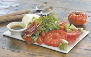 Caprese salad with crispy prosciutto, from a cookbook by swimsuit model Chrissy Teigen and styled by Sarah Abramsi. (AP Photo)