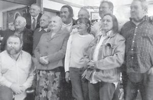 — The children of the late Polly and Leslie Howard, (back row, left to right) Kern, Melvin, Leonard, Fred, Lee, Earl Jr., Dexter, (front row) Leroy, son of Bob Howard; Ida, Betty Jean and Mary Lou, gathered in Fort Wayne, Ind., for memorial services for their brother, Bob Howard, and Garland Howard, who died close together.