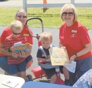 Pictured are (left to right) Whitaker Bank employee Sandy Bailey, Ayden Hall, who receives free books from the Imagination Library, and Rotarian Margaret Hammonds with Ayden's younger brother, Cameron, who was among the 18 children who registered for the program during the recent Back-to- School Bash event. Ayden and Cameron are the children of Jessica and Justin Hall of Mayking. The Imagination Library program is available to children under the age of five who reside in Letcher County. Children receive a free book each month until they turn five years old. To register a child for the program, visit www.imaginationlibrary.com or contact Margaret Hammonds at 606-633-8200. The Imagination Library in Letcher County is sponsored by the Rotary Club of Whitesburg.