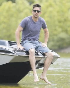 """Country music star Jake Owen poses in his boat on the Cumberland River near Nashville, Tenn. Owen's latest album, """"American Love,"""" is now available. (AP Photo)"""