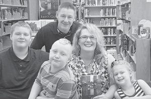 Pictured are author Missy Torrey with husband David Torrey and their children Josh Torrey, Caleb Torrey, and Nora Torrey.