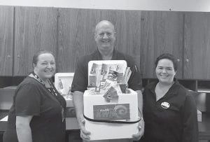 Letcher County Sheriff Danny Webb recently expressed this gratitude to Double Kwik and the entire Letcher County area for their continued support of him and the people in his department. Michelle Holbrook, manager of the Ermine Arby's and Double Kwik, and Jamie Breeding, manager of Dry Fork Double Kwik, recently brought police appreciation packages to the Letcher County Sheriff 's Office to voice their and Double Kwik's support of local law enforcement. They are pictured with Deputy Sheriff Barry Engle.