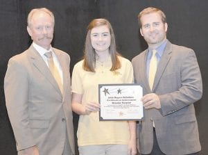 Lonnie Lawson (left), president and CEO of The Center for Rural Development, and Delaney Stephens (right), youth programs coordinator and community liaison for The Center, present 2016 Rogers Scholar graduate Brooke Sauer with a certificate for completing the program. Sauer, 16, is a student at Letcher County Central High School.