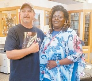 """Author Bessie Sims, a former McRoberts resident, recently participated in a book signing at the Jenkins Public Library. Jenkins Mayor Todd Depriest was one of many who attended to get a copy of the book, """"Words of Truth"""", and to welcome her back to Letcher County."""