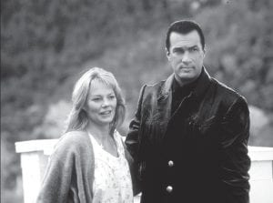 "Actors Marg Helgenberger and Steven Segal in a scene from the film ""Fire Down Below."""