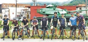 Members of the Letcher County Cycling Club gathered for a photo before riding early on a foggy morning. They are (from left) Michael Hatfield, Chelsie Madden, Erik Arroz, Charlie Beverly, Justin Keene, Wesley Sturgill, Chris Adams, Ryan Sexton, and Winston Lee.