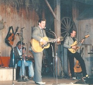 Chuck Johnson (center) is seen during his first appearance at the Renfro Valley Barn Dance during the late 1980s.