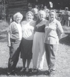 """TOGETHER AGAIN — (Left to right) Martha Dixon Burns, Oma Howard Hatton, Joanna Back Walters and Hope Back Campbell started first grade together. They attended the Elk Creek reunion held in 1999 at the home of Dr. Artie Ann Bates. Whitesburg correspondent Oma Hatton said, """"I've enjoyed seeing Martha Burns and Joanne Walters at Senior Citizens."""""""
