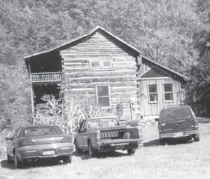 This is the log cabin of Dr. Artie Ann Bates on Elk Creek. It was built in the early 1850s. Whitesburg correspondent went to a reunion there in 1999 and says she enjoyed seeing all the people there, and especially a fat pig lying around and being fed by everyone.