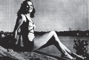 This photograph of Miss Kentucky 1946 Madonna Smith of Jenkins appeared in the Courier-Journal of Louisville on September 1, 1946 and shows Miss Smith on the banks of the Ohio River.