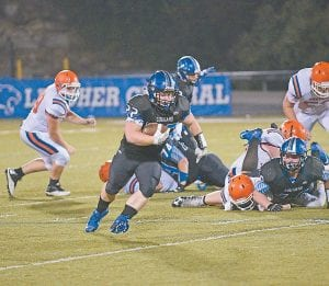Letcher Central senior Preston Maggard bulldozed his way downfield in Friday's 28-20 season-opening win over Pike Central. (Photo by Chris Anderson)