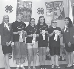 The Letcher County 4-H Senior Horticulture Team won Reserve Grand Champion at the state fair. Pictured with Kentucky 4-H state officers are (left to right) Cody Adams, Carla Sturgill, Brooke Saurer and Annie West.