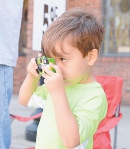 Braxton Bentley was taking some photos of his own during Saturday's Homecoming Days parade in downtown Jenkins. Letcher County's annual fesitval season is hitting full stride with the focus turning to Isom Days this week. (Photo by Chris Anderson)