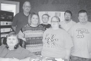 Friends at WXKQ helped Grayson Holbrook celebrate her 21st birthday with an ice cream cake. Pictured are M.K. Combs, Beth Wright, Jaden Wright, Bob Scott, Larry K. Day, Kevin Day and Grayson Holbrook. Not pictured is Shirley Sexton.