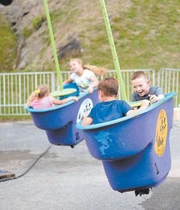 Shawn-Michael Collier smiled as he and Andrew Newsome went round and round in the tubs at the Jenkins Homecoming Days carnival.