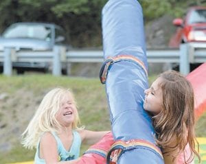 Olivia Kelly, left, collided with her sister Nyla on one of the attractions.