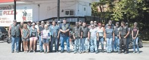 Riders participating in the annual Jenkins Homecoming Days Benefit Ride posed for a photo before departing. This year's ride benefited 3-year-old Hunter Ashley, who is battling leukemia.