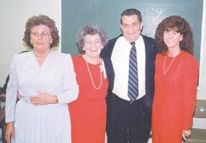Sisters of Whitesburg correspondent Oma Hatton, the late Louise Shepherd, the late Kathleen Brock, and Joanne Brown, who lives in Indianapolis, Ind., are pictured with their cousin, the late Leonard Howard.