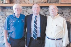 Pictured (left to right) are Ozz Jackson, Letcher County Central High School Coach Junior Matthews and Jack Burkich.