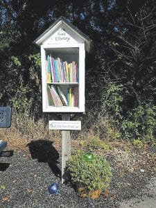 The Isom Park Little Free Library was made out of a large antique box by Gwen Rollins and Jim Croucher.
