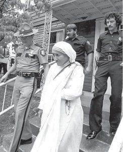 Officers with the Kentucky State Police and Jenkins City Police escorted Mother Teresa during her 1982 visit to Jenkins, where a convent she opened then remains vital today. (Photo by Charles Bertram, courtesy Lexington Herald-Leader)