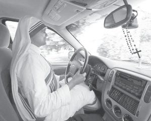 Sister Suma Rani drives the nuns' fourwheel drive SUV to make home visits after leaving the Missionaries of Charity convent early last week. (Photo by Charles Bertram/Lexington Herald-Leader)