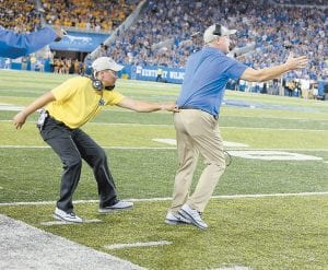 FLEEING THE SCENE OF AN ACCIDENT? WELL … It would be hard to blame Kentucky coach Mark Stoops for running as hard as he could to get out of Commonwealth Stadium in Lexington last Saturday night after his team blew a 35-10 halftime lead while on its way to losing to Southern Mississippi, 44-35. Stoops called the loss embarrassing and apologized fans after the game. (Vicky Graff Photo)