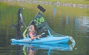 — Taylor Herron sported perhaps the most eye-catching decorations during last Saturday's inaugural Glow on the Pond at Fish Pond Lake event. Herron, seen here waiting for darkness, was one of almost 30 kayakers to participated in the fun. (Photo by Chris Anderson)