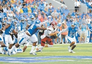 Despite numbers to the contrary, UK linebacker Courtney Love thinks the Kentucky defense is improving despite giving up 42 points and 500 yards to New Mexico State. (Photo by Vicky Graff )