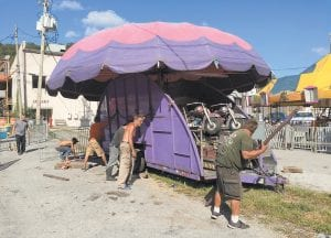 — Workers with Derby City Attractions of Louisville worked in 90-plus degree temperatures Tuesday afternoon while setting up carnival rides for the annual Letcher County Mountain Heritage Festival, which is being held in Whitesburg this week. The carnival is located in the public parking lot beside the Graham Memorial Presbyterian Church and behind the Letcher County Courthouse. (Eagle photo)