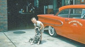 Chief Remious Day's son, Raymond Lee Day, played with a Dalmation that served as the firehouse mascot when this photo was taken in the early Sixties.