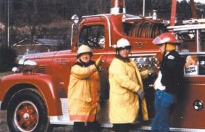 The late Shade Frazier, left, and the late Morris Mullins, center, were longtime volunteer firefighters who were honored. At right is present Coroner Perry Fowler.