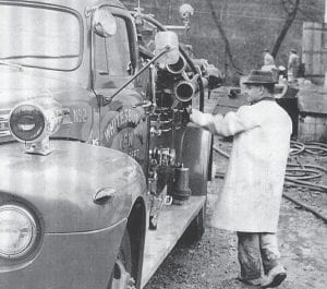 Late Whitesburg Fire Chief Philmore Bowen was chief of the VFW Fire Department in Whitesburg when this photo was taken at the scene of a fire at the RC Cola Bottling Plant at Ermine in 1966, a short time before Bowen would replace Chief Remious Day.