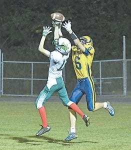 Jenkins' Lance Bentley went into the air to break up a pass in the end zone in Friday's loss to Hazard at home. Jenkins is still searching for its first win, but looks to repeat last year's victory over Phelps when the two team square off this week.