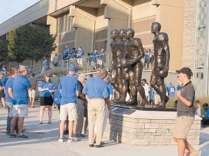 Fans took time to view the new statue outside Commonwealth Stadium honoring four former UK players who broke the color barrier in the SEC. (Photos by Vicky Graff )
