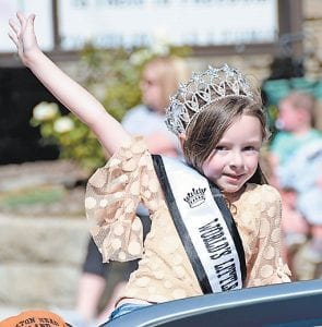 Little Miss Kentucky Tourism Morgan Profitt gives a big wave to the parade crowd lining Main Street.