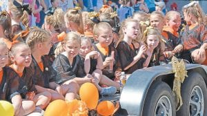 The West Whitesburg Elementary Cheerleaders enjoy their ride through Saturday's parade.