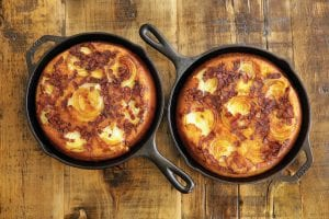 Onion cornbread baked in cast iron skillets. This dish is from a recipe by Elizabeth Karmel. (AP Photo/Richard Drew)